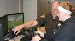 sheriff showing student safe driving simulator