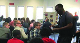 inmate talks to students