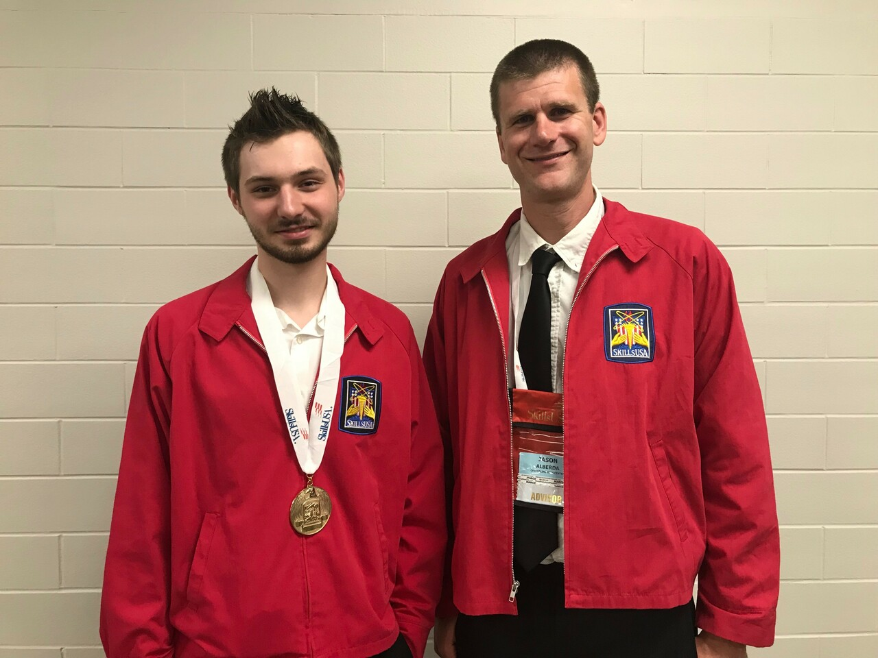 devries and teacher at competition with medal